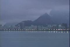 Approaching Rio de Janerio at dawn from the water over the harbor, foggy Stock Footage