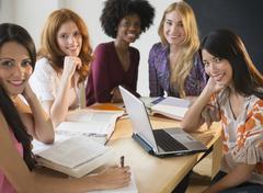 Stock Photo of Businesswomen smiling in meeting