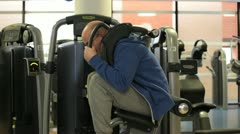 In a gym working out a man his training stomach muscles Stock Footage