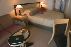 Queen Mary 2, ocean liner, standard cabin, king size bed - stock footage