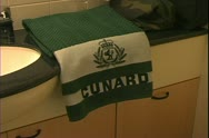Stock Video Footage of Queen Mary 2, ocean liner, standard cabin, Cunard towels