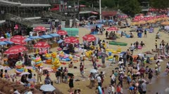 A lot of people at crowded bathing beach.China's Qingdao City.swim ring. Stock Footage