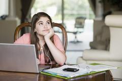 Bored Caucasian girl doing homework Stock Photos