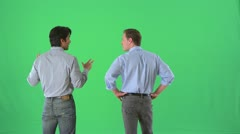 Businessmen talking in business casual attire on greenscreen - stock footage
