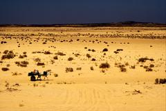 People in the desert of tunisia Stock Photos