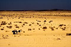 people in the desert of tunisia - stock photo