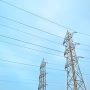 two transmission towers, also known as electricity pylons. - stock photo