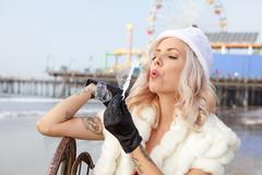 Attractive woman in Santa Claus costume - stock photo