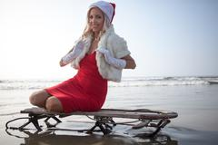 Attractive woman in Santa Claus costume - stock photo