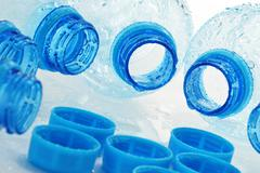 Composition with empty polycarbonate plastic bottles of mineral water Stock Photos
