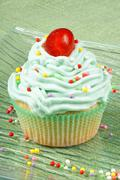 cupcake with candied cherry - stock photo