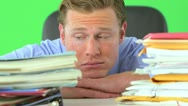 Businessman distressed over paperwork on greenscreen Stock Footage