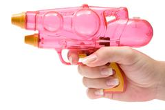 Holding a Water Pistol Isolated on a White Background - stock photo