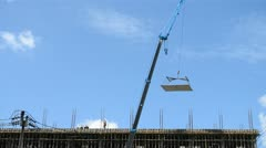 crane working on tower in construct site - stock footage