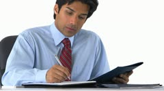 East Indian businessman taking notes Stock Footage