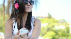 Girl listening music on mobile phone with earphone - stock footage