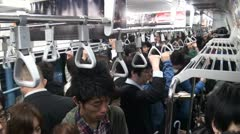 Inside a train during Tokyo rush hour, people going to work - stock footage