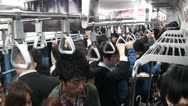 Stock Video Footage of Inside a train during Tokyo rush hour, people going to work