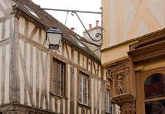 city of Auxerre, medieval decoration in the angle of a street  Burgundy  France - stock photo
