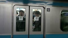 Departing commuter train, reflection on window, Tokyo, Japan Stock Footage