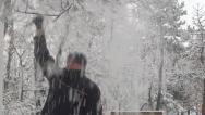 Man Enjoying Winter in Park, People have Fun in Snow, Snowing Game Stock Footage