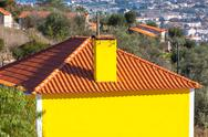 Stock Photo of exterior of bright yellow rural house