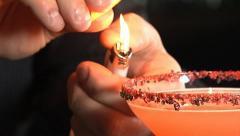 Bartender lights martini on fire Stock Footage