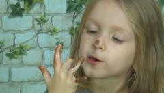 Child Licking Chocolate off Finger, Little Girl Eating Chocolate, Food, Children Stock Footage