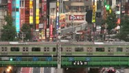 Shinjuku crossing neon trains nightlife commute Tokyo Japan Stock Footage