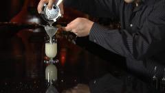 Bartender mixes fancy drink Stock Footage
