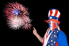 patriotic man and fireworks - stock photo