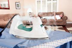 man ironing - stock photo