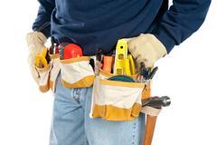 Man wearing tool belt Stock Photos