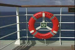 The Queen Mary 2, ocean liner, sailing at sea, ring buoy, life preserver - stock footage