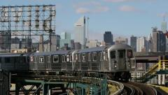 New York City Manhattan skyline midtown and subway train Stock Footage