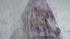 Snowing over a Child, Little Girl Playing in Snow, Winter Games Stock Footage