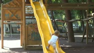 Child Playing in Park, Little Girl Sliding on a Slide at Playground, Children Stock Footage