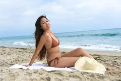 Asian woman sunbathing Stock Photos