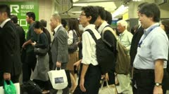 Rush hour at the busiest train station in the world, Shinjuku, Tokyo, Japan Stock Footage
