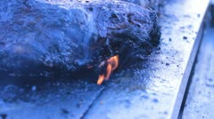 Fire under meat on a BBQ Stock Footage