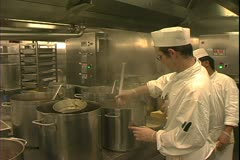 Queen Mary 2 ocean liner, galley, kitchen, chefs ladle soup Stock Footage