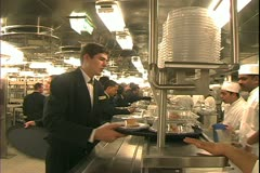 Queen Mary 2 ocean liner, galley, kitchen, dining stewards pickup meals Stock Footage