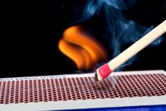 Matchstick on fire Stock Photos