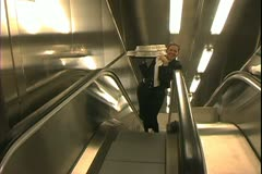 Queen Mary 2 ocean liner, galley, kitchen, pickup meals, carry on escalator - stock footage