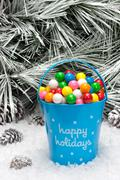 decorative pail of christmas gumballs - stock photo