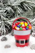 Decorative pail of christmas candy Stock Photos