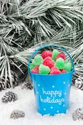 decorative pail of christmas candy - stock photo