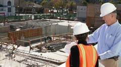 Construction Architect Discusses Plans with Construction Forewoman Worker Stock Footage