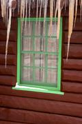 Cabin window with icicles Stock Photos