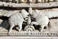 elephants on ranakpur temple in india - stock photo